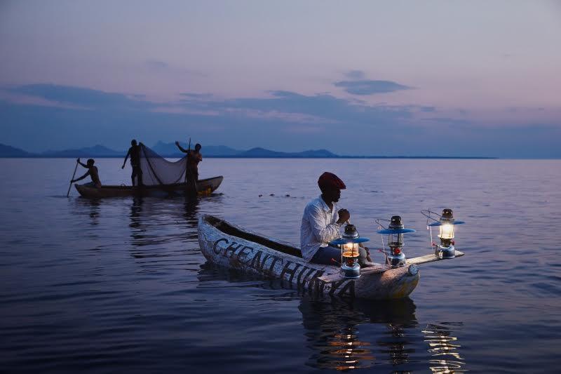 Fishermen on Lake Malawi at dusk.